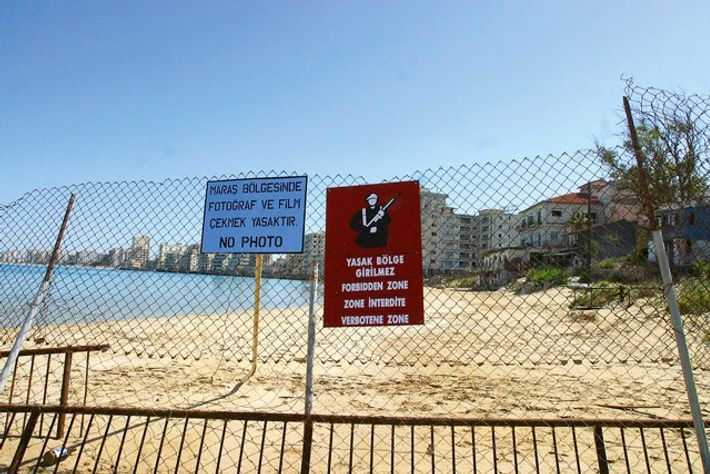 View of Famagusta's coast with the deserted hotels of the fenced-off area of Varosha. Image: Getty