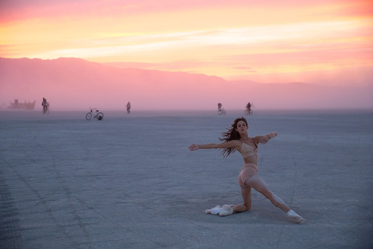 Belle, a classically trained dancer from New York City, does an improvisational dance on the Playa.