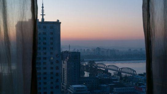 The sun sets over Dandong, China.