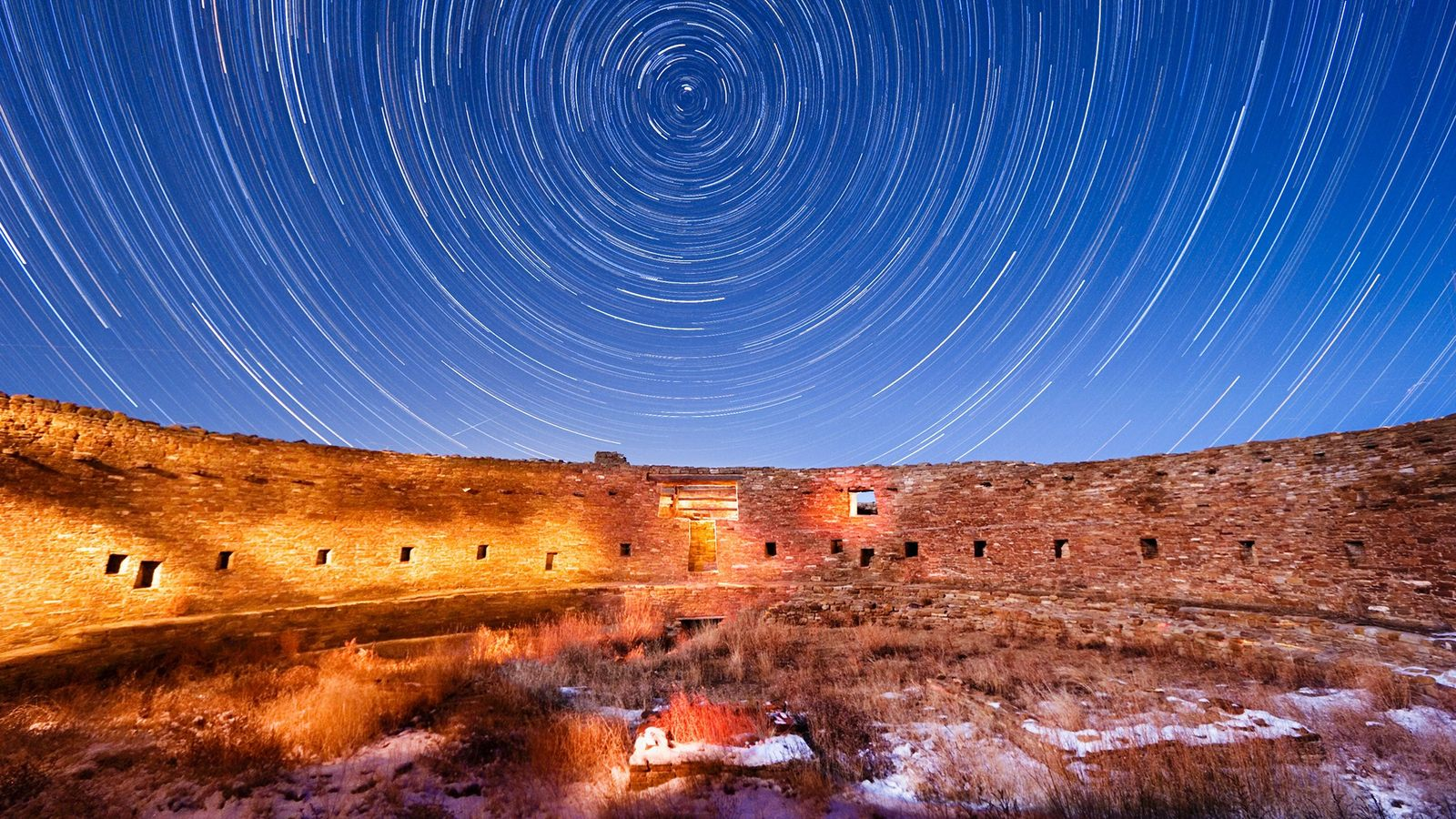 Stars whirl in time-lapse above Casa Rinconada, an Ancestral Puebloan site in Chaco Canyon.