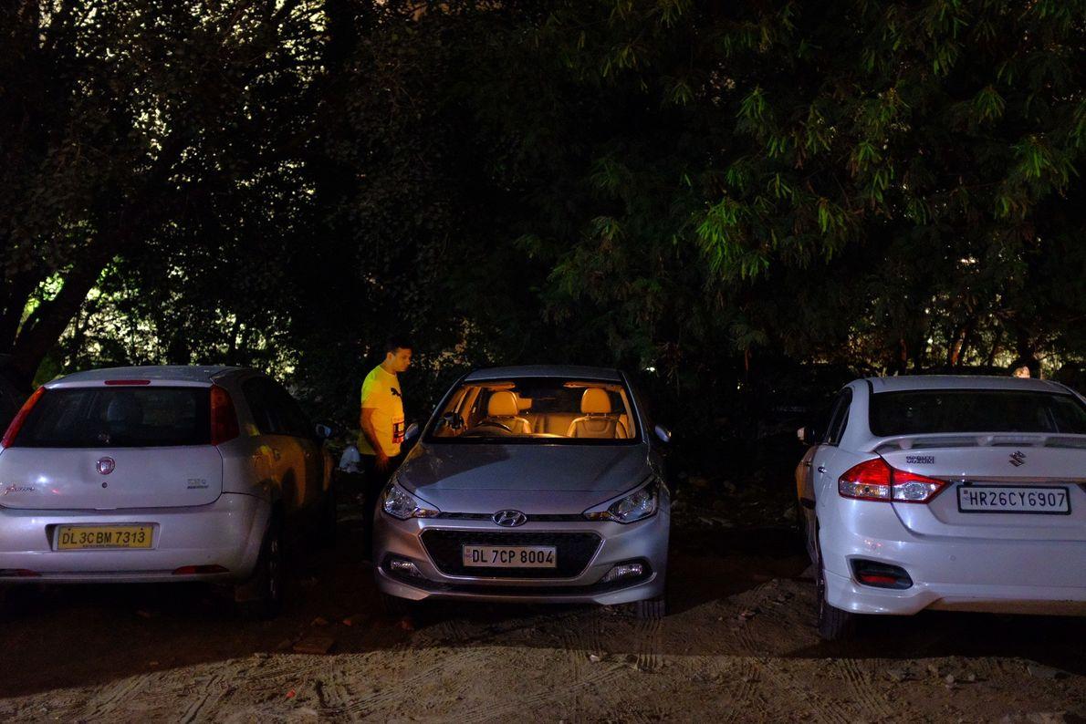Preparations for the Delhi marathon take place in a parking lot near the Jawaharlal Nehru Stadiumin ...