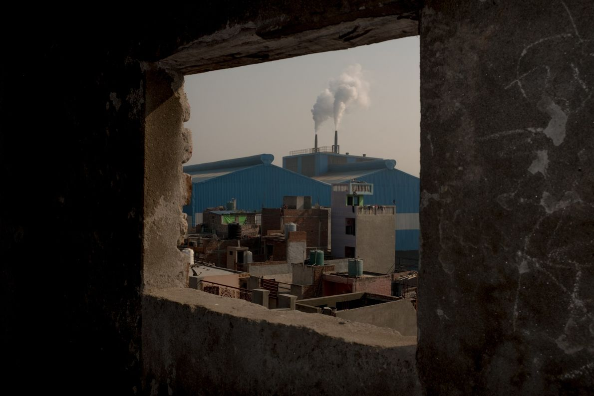Smoke billows from a factory in the industrial zone of Sahibadab on the outskirts of Delhi.
