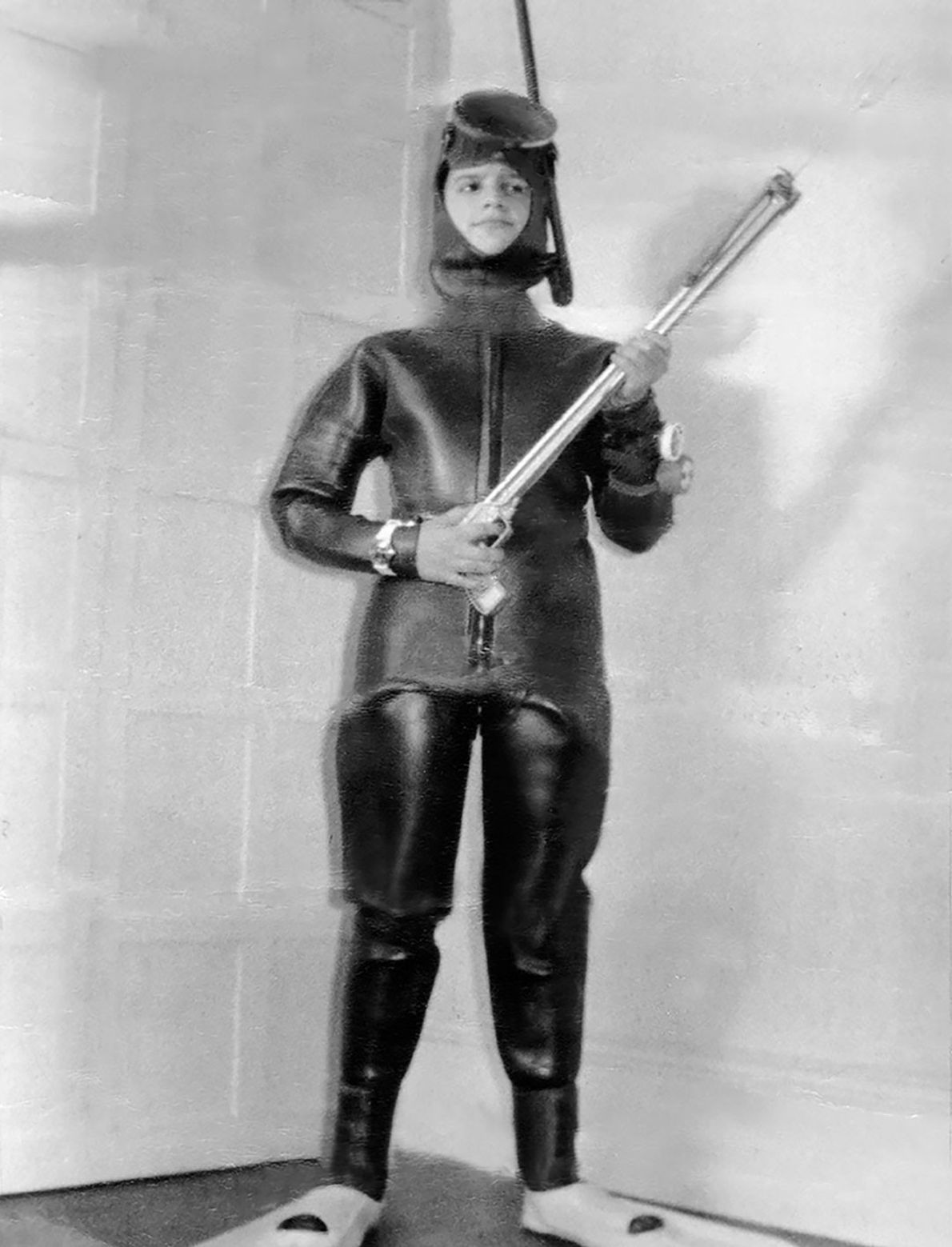 A 13-year-old David Doubilet models his birthday gift of wetsuit and spear gun.