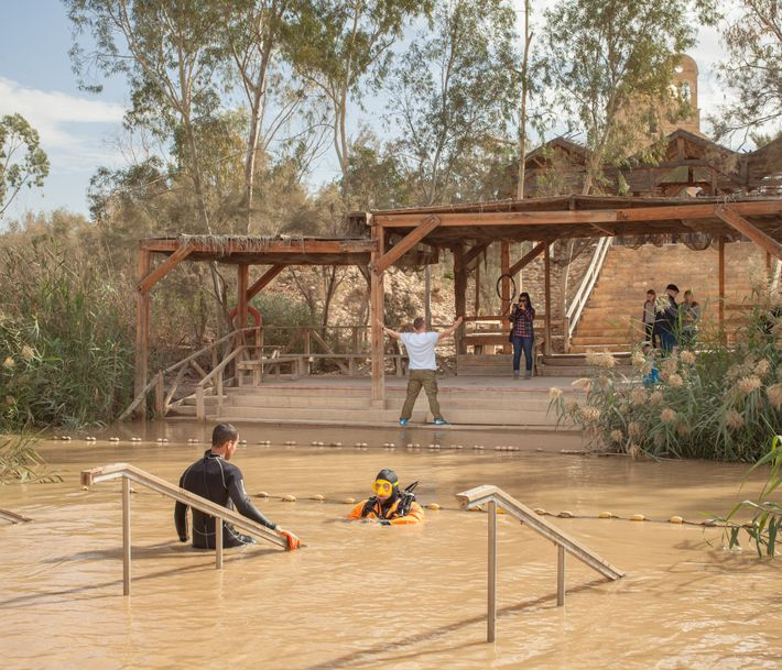 A diver is working on conserving the little artificial basin in the Jordan River where Christian ...