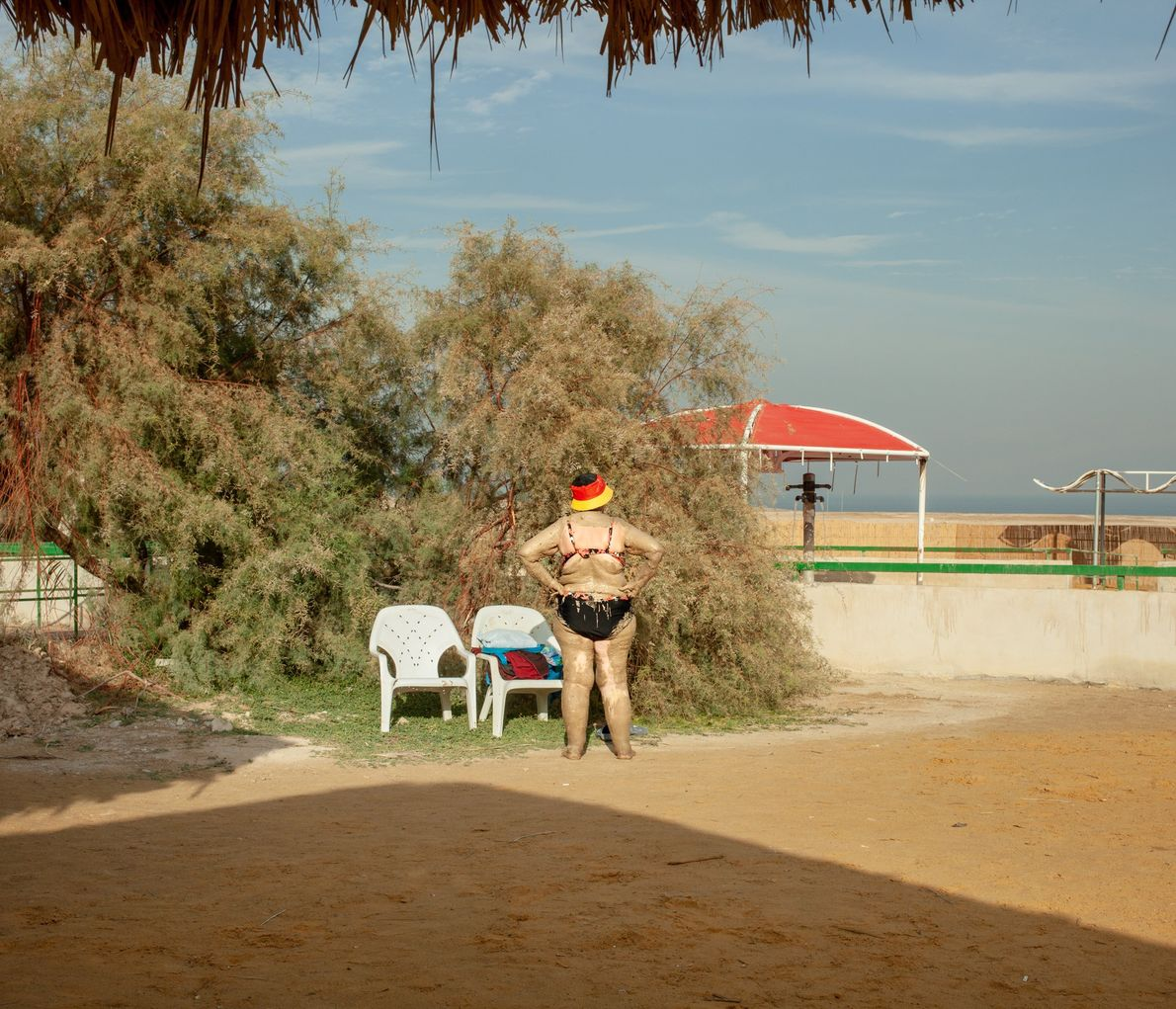 A bather enjoys Ein Gedi Hot Spring at the Dead Sea. Since before the time of ...