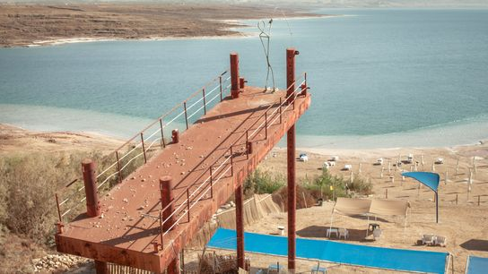 The Dead Sea is drying so quickly that it is leaving infrastructure and the shoreline in ...