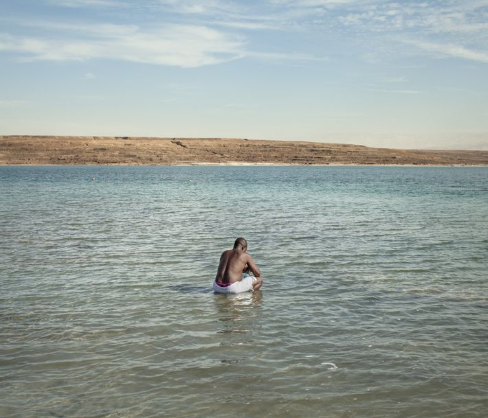 A Nigerian tourist enjoys the Dead Sea.
