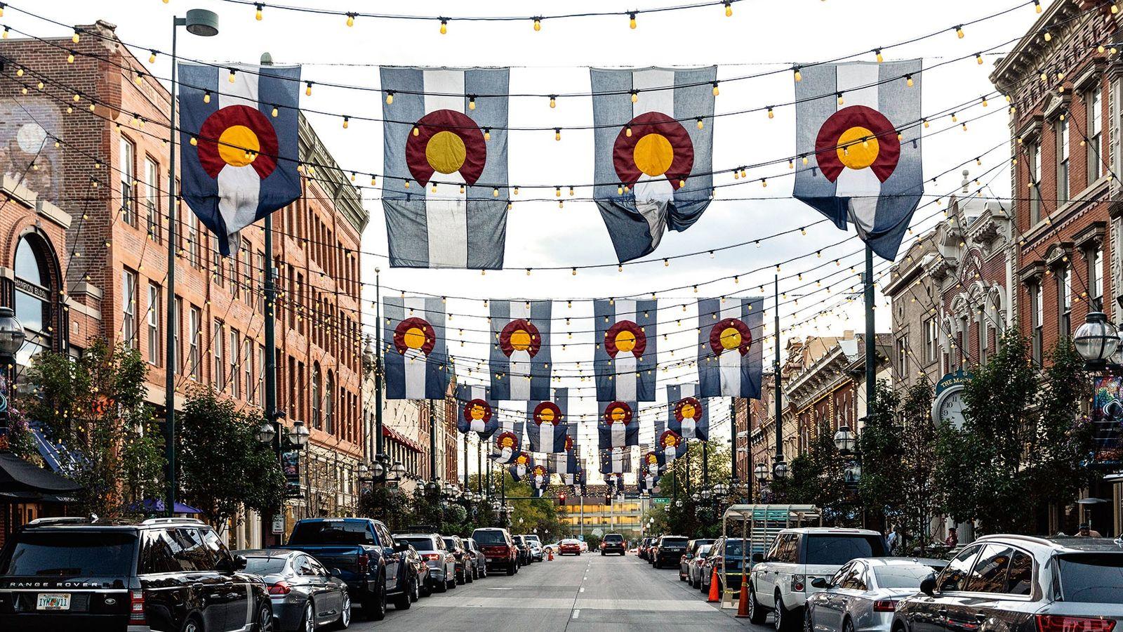 Flags fly over Denver's historic Larimer Square.
