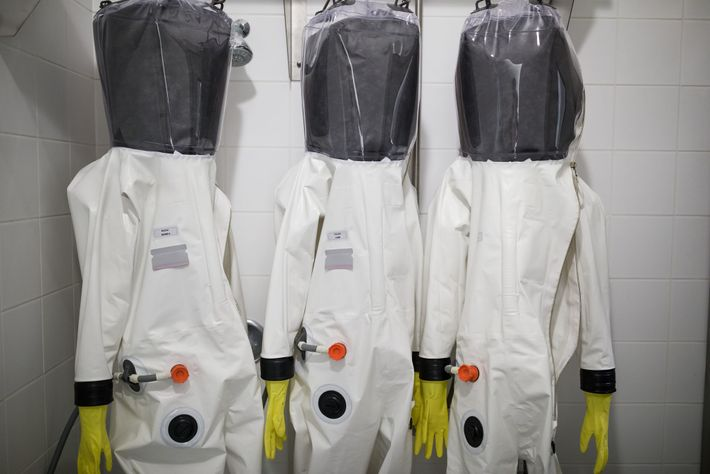 """Scientists working with infectious agents may wear airtight """"positive pressure"""" suits designed to prevent contamination from ..."""