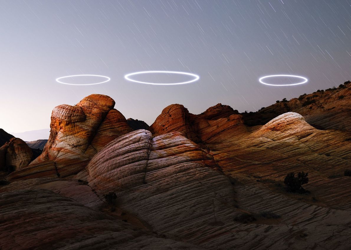 Photographer Reuben Wu programmed lit drones to circle above Utah's Yant Flat sandstone formations, then combined ...