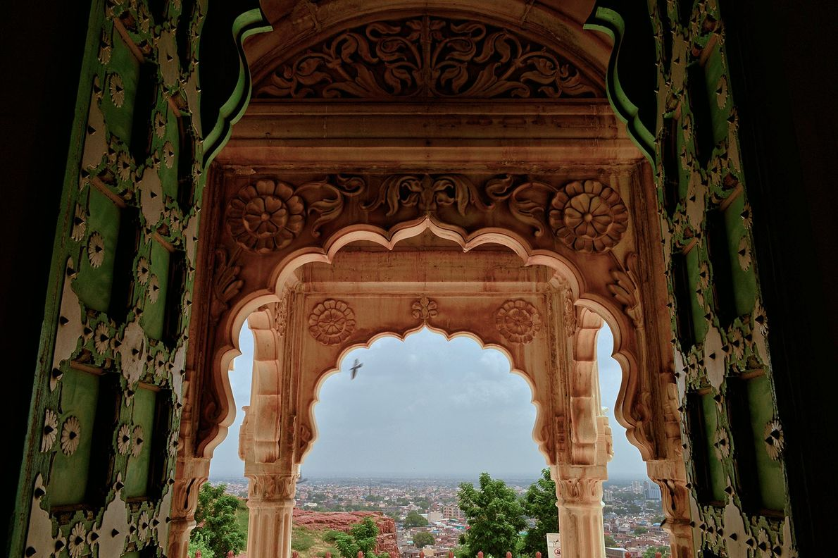 A picture I took in Jodhpur, Rajasthan, India. The combination of the big green doors, yellow ...