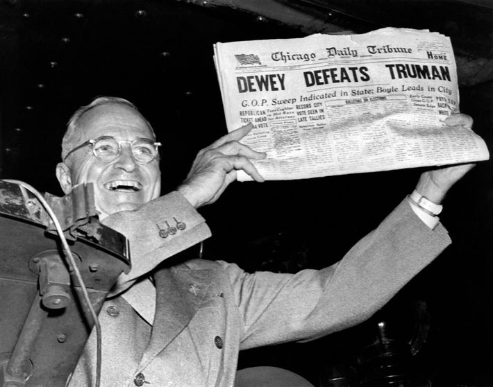 President Harry Truman holds up a copy of the Chicago Daily Tribune declaring his defeat to ...