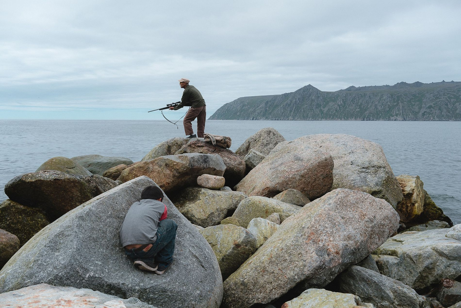 Ed Soolook, a retired U.S. Army veteran and Native Alaskan, searches for a seal that ducked ...