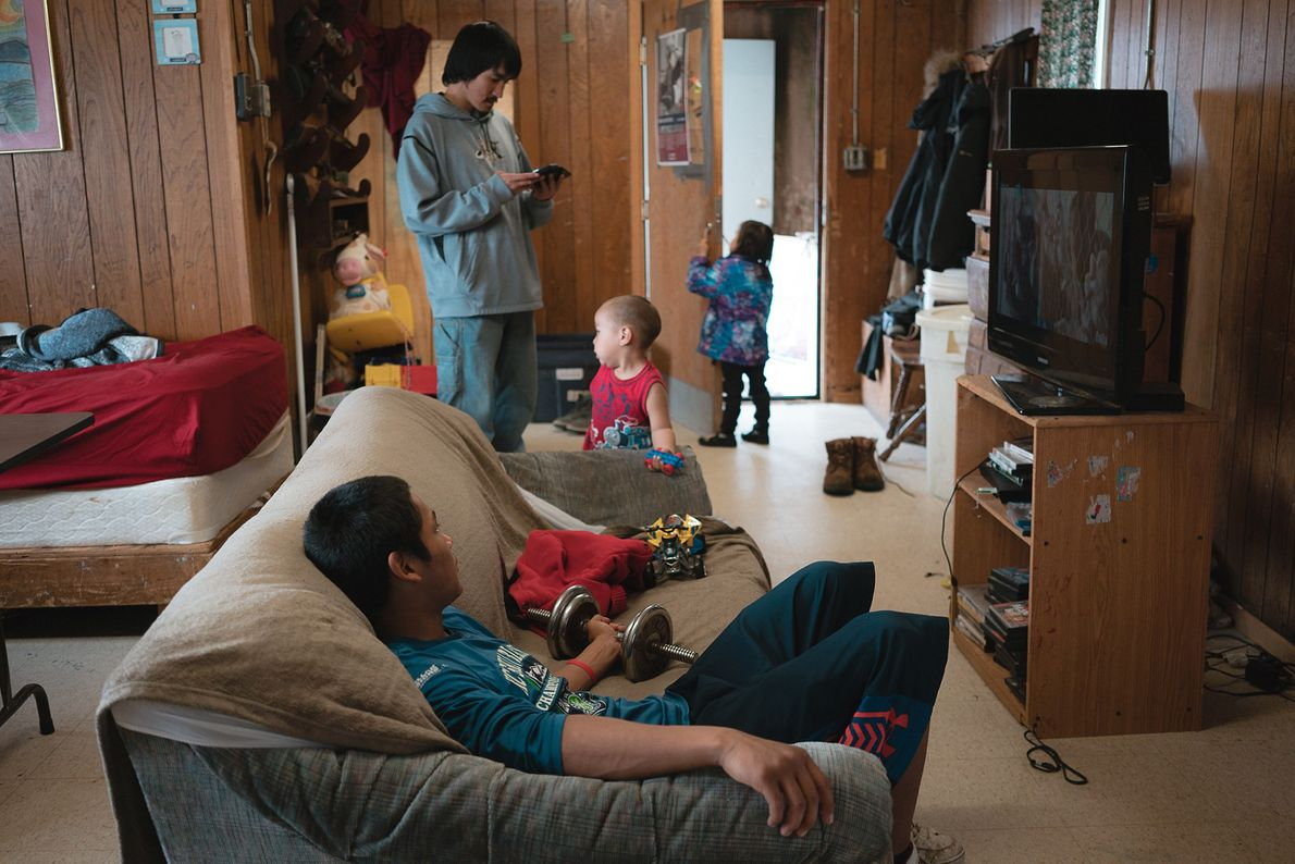 Kevin Ozenna relaxes at home in the island's sole village, which is home to about a ...