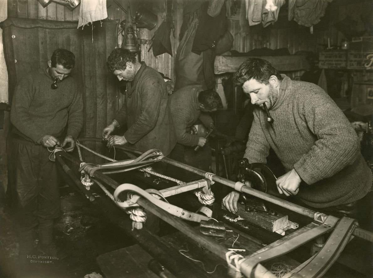 Men construct a sledge used to haul items during the expedition. The South Pole team took ...