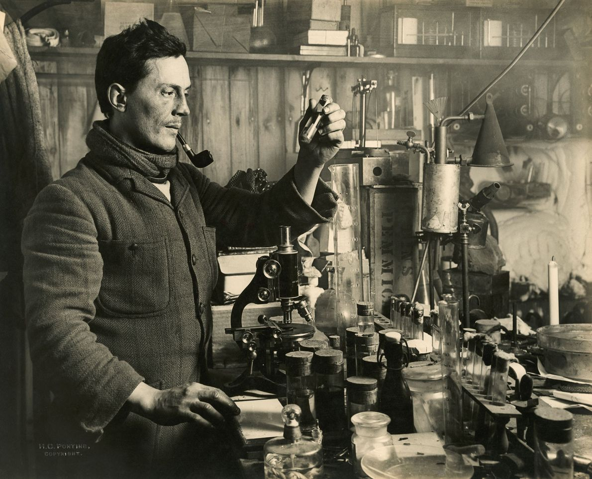 Doctor Edward Atkinson conducts experiments in his lab during the expedition. Part of Scott's goal was ...
