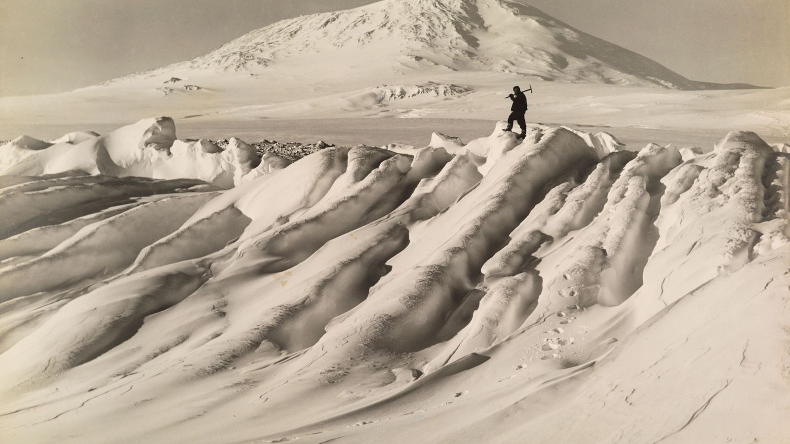 A member of Robert Falcon Scott's Terra Nova expedition to the South Pole stands on a ...