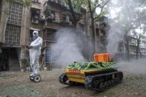 A tank robot sprays disinfectant in the streets of Wuhan, China, on March 16. Experts now ...