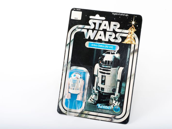 Preserved in its box, an original 1977 Kenner 'R2D2' Star Wars toy.