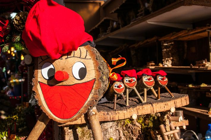 Tió de Nadal, a Christmas tradition in Catalonia, waits on sale at a Christmas market in ...