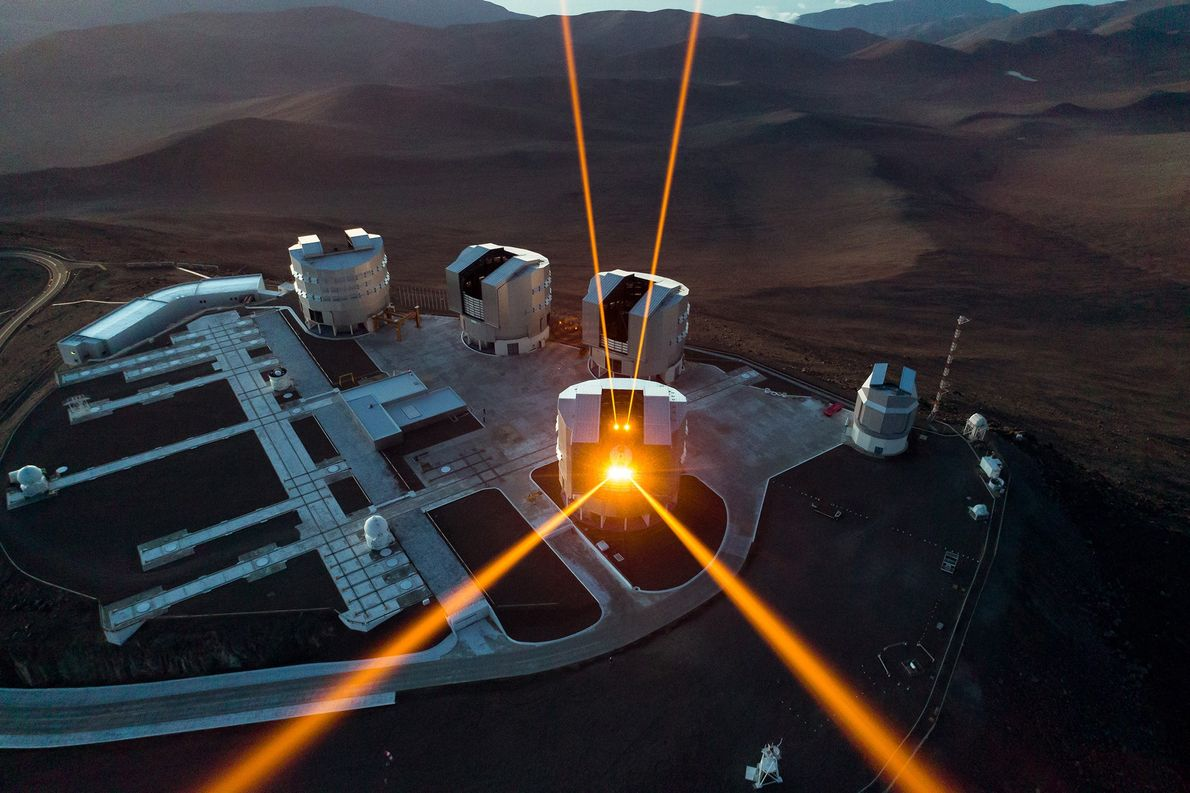 Four orange lasers cut through the skies above Chile's Atacama desert, the home of ESO's Very ...