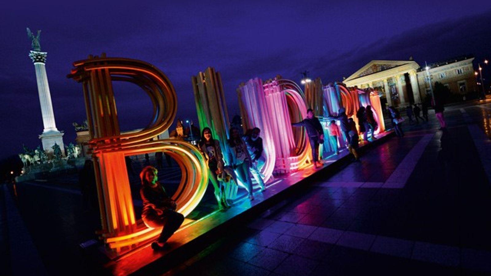 Giant illuminated 'Budapest' sign at Heroes Square, Budapest.
