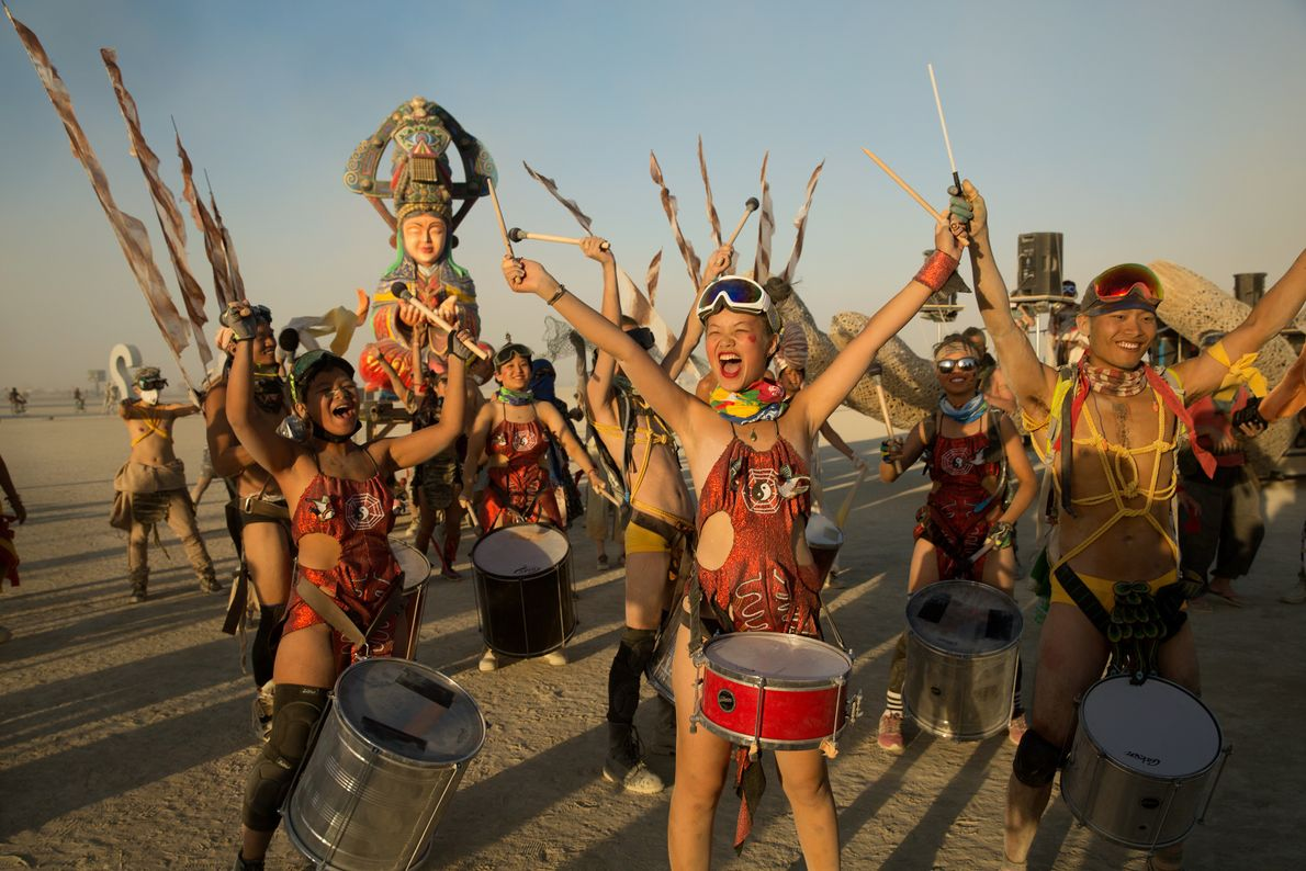A group of costumed revellers from Taiwan plays drums at Mazu Camp at sunset.
