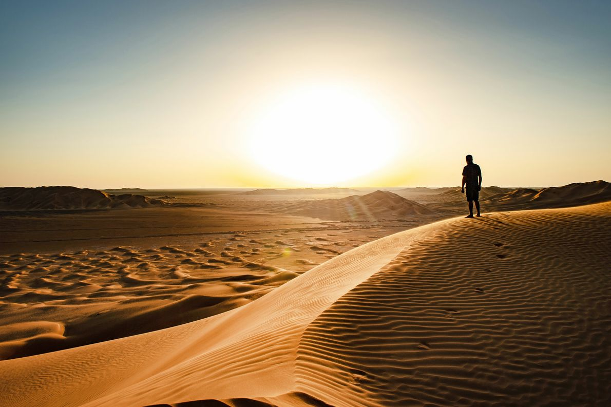 The towering sand dunes encircling Bedouin campsites in the Rub' al Khali provide elevated platforms from which ...