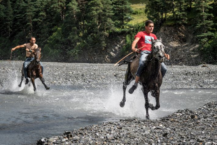 Traditional Tushetian festivities, called atingenebi, are marked by competition. The khitanoba is a horse race (right) ...