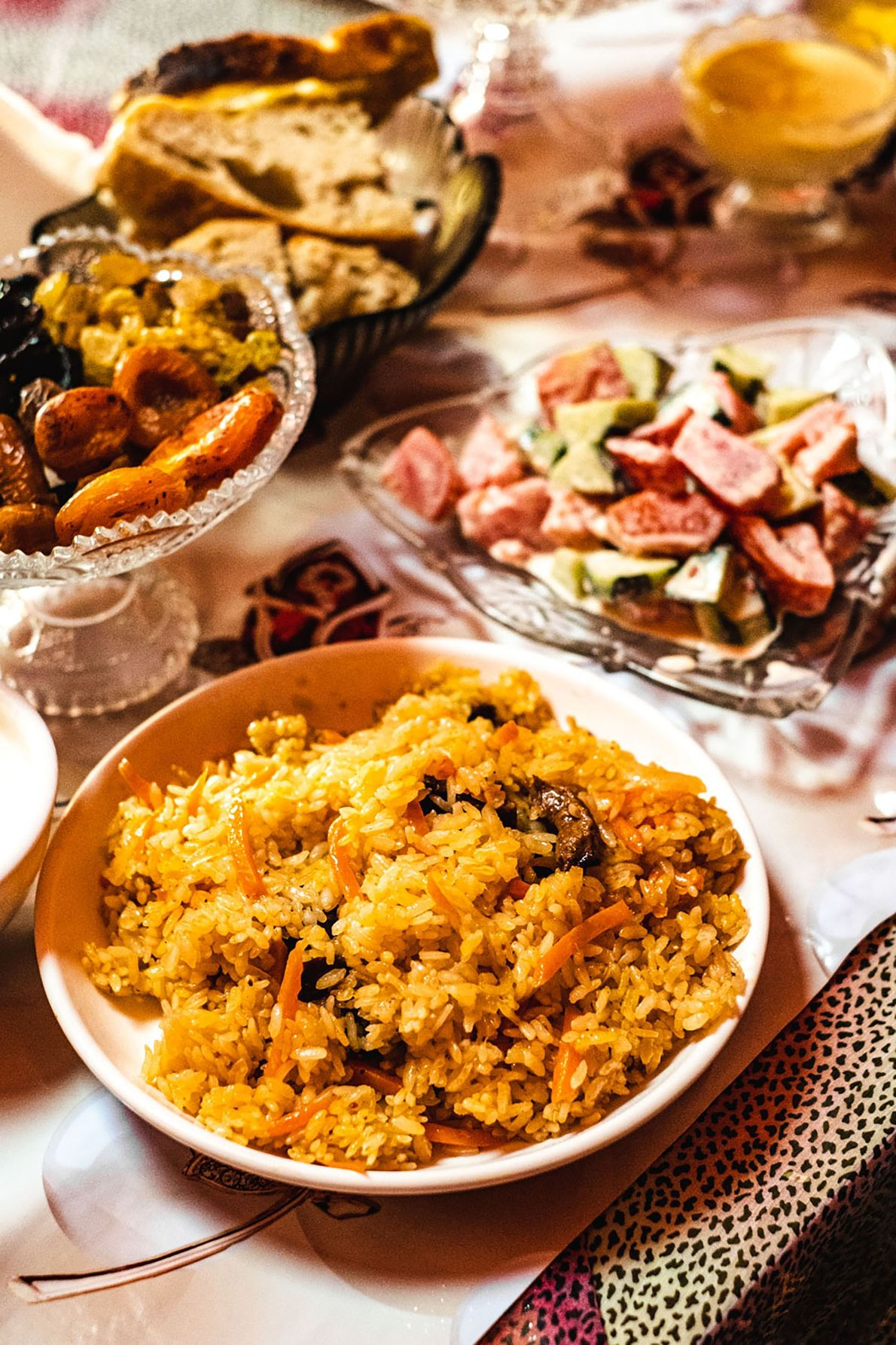 Freshly made plov and a typical summer salad of tomatoes and cucumbers with kaymak - thick, ...