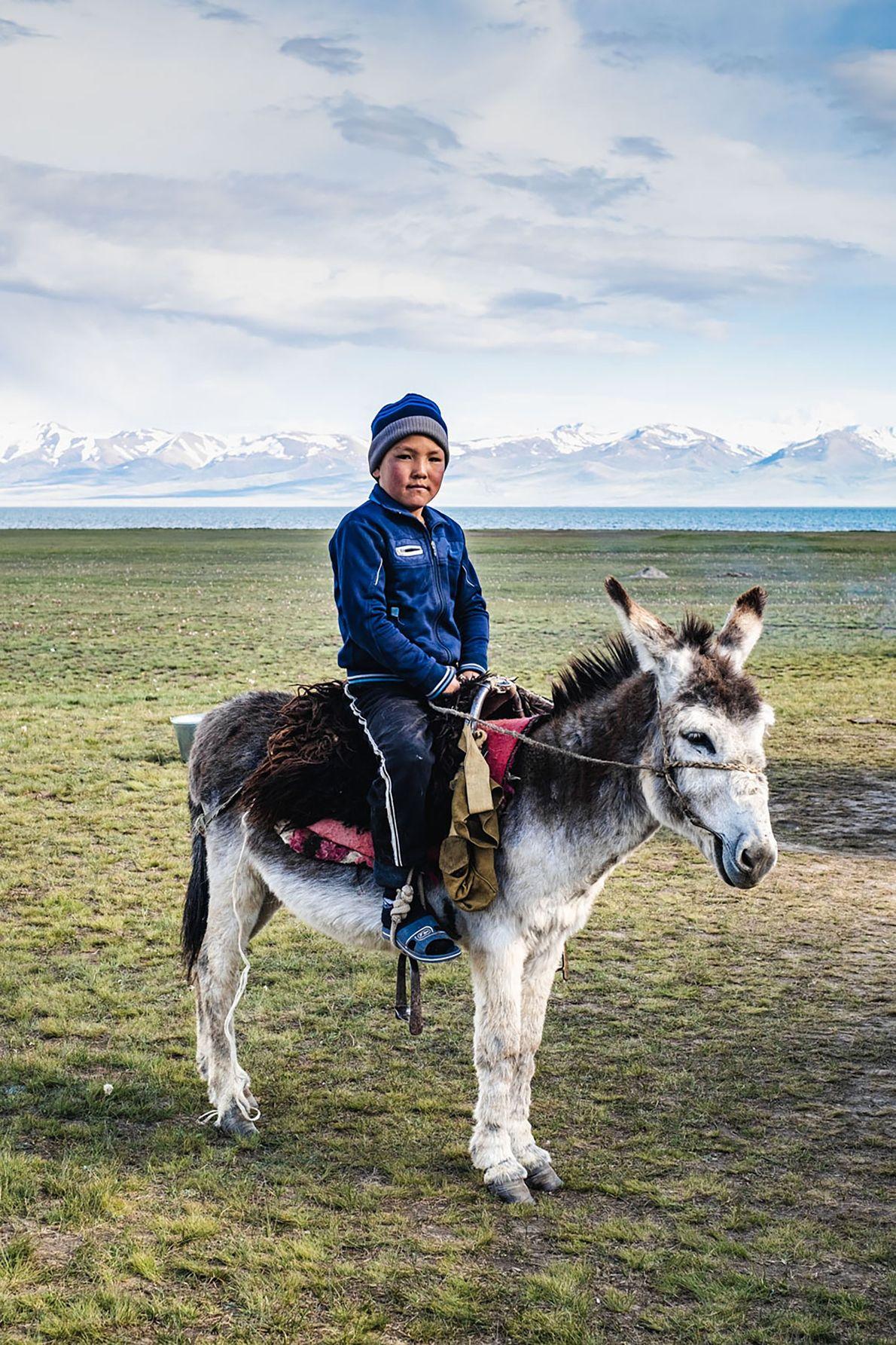 Umutkor's younger sun, Aibek, proudly sits on his donkey.