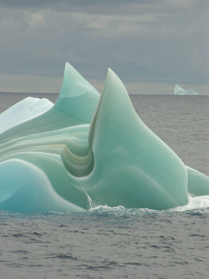 A weathered 'jadeberg' sails like an alien ship through the waters of Antarctica.