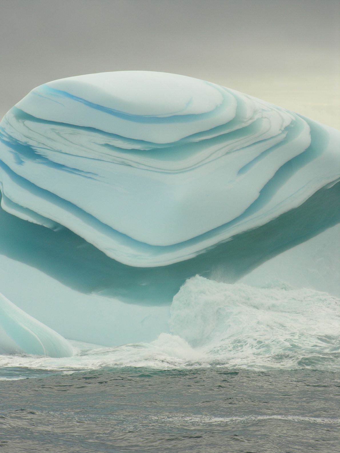 Bands of green and white ice give this jade berg an unusual appearance.