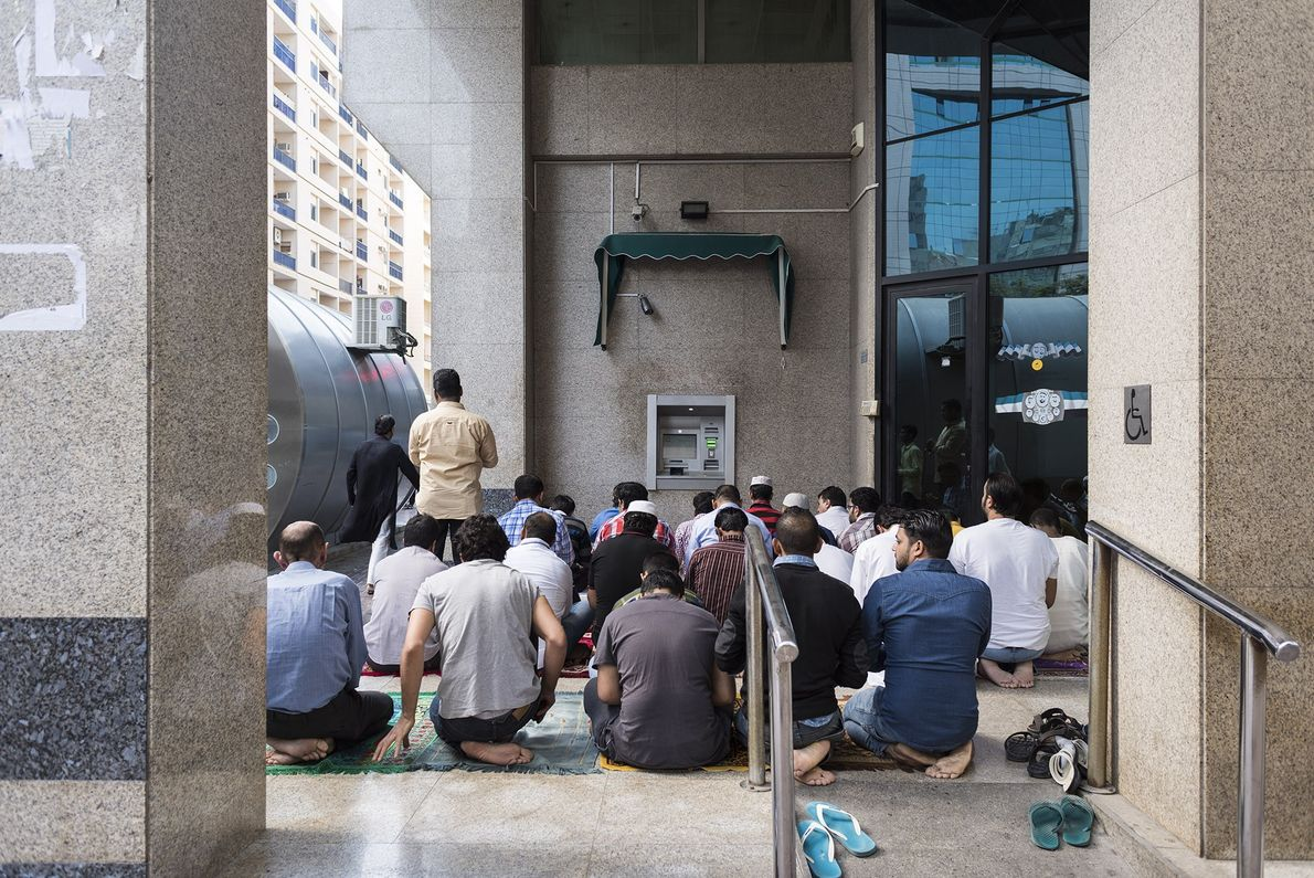 Muslims pray in the streets adjacent to the mosque in Deira, which is mainly inhabited by ...