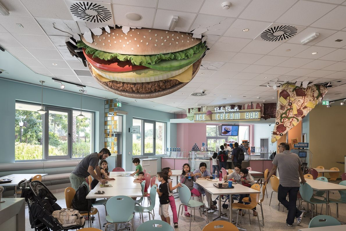 A giant burger and pizza slice hang from the ceiling of Baby Brent's Luncheonette at Motiongate, ...