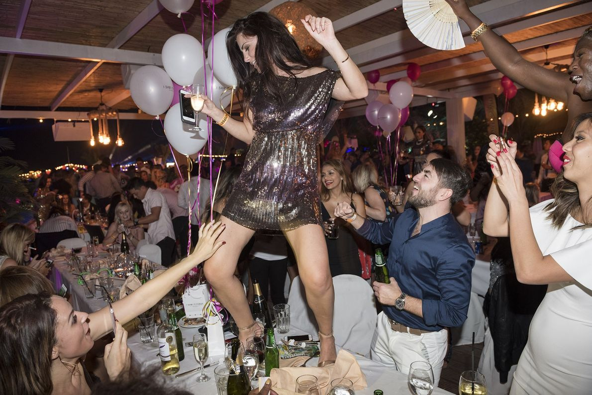 A girl dances on the table during the New Year's Eve Candypants Party at the XL ...