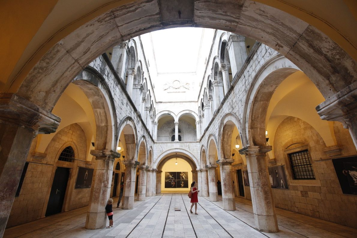 Sponza Palace was Dubrovnik's customs office and now houses an exhibit of photos of those who ...