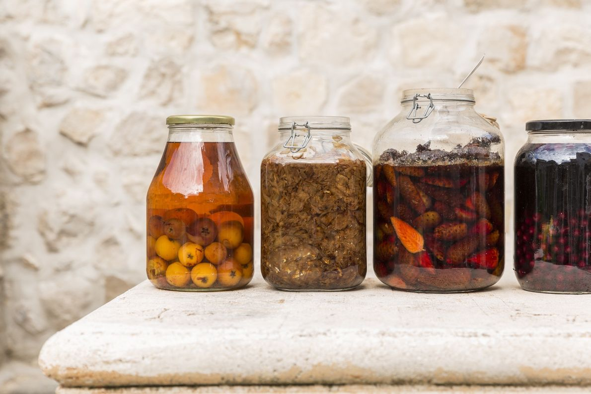 Jars store preserved loquats, edible antique rose petals with sugar and grappa (used to make rose ...