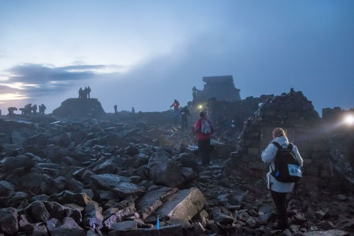 Charity challengers reaching the 1,345m summit of Ben Nevis, in Scotland's central Highlands. The highest ground ...