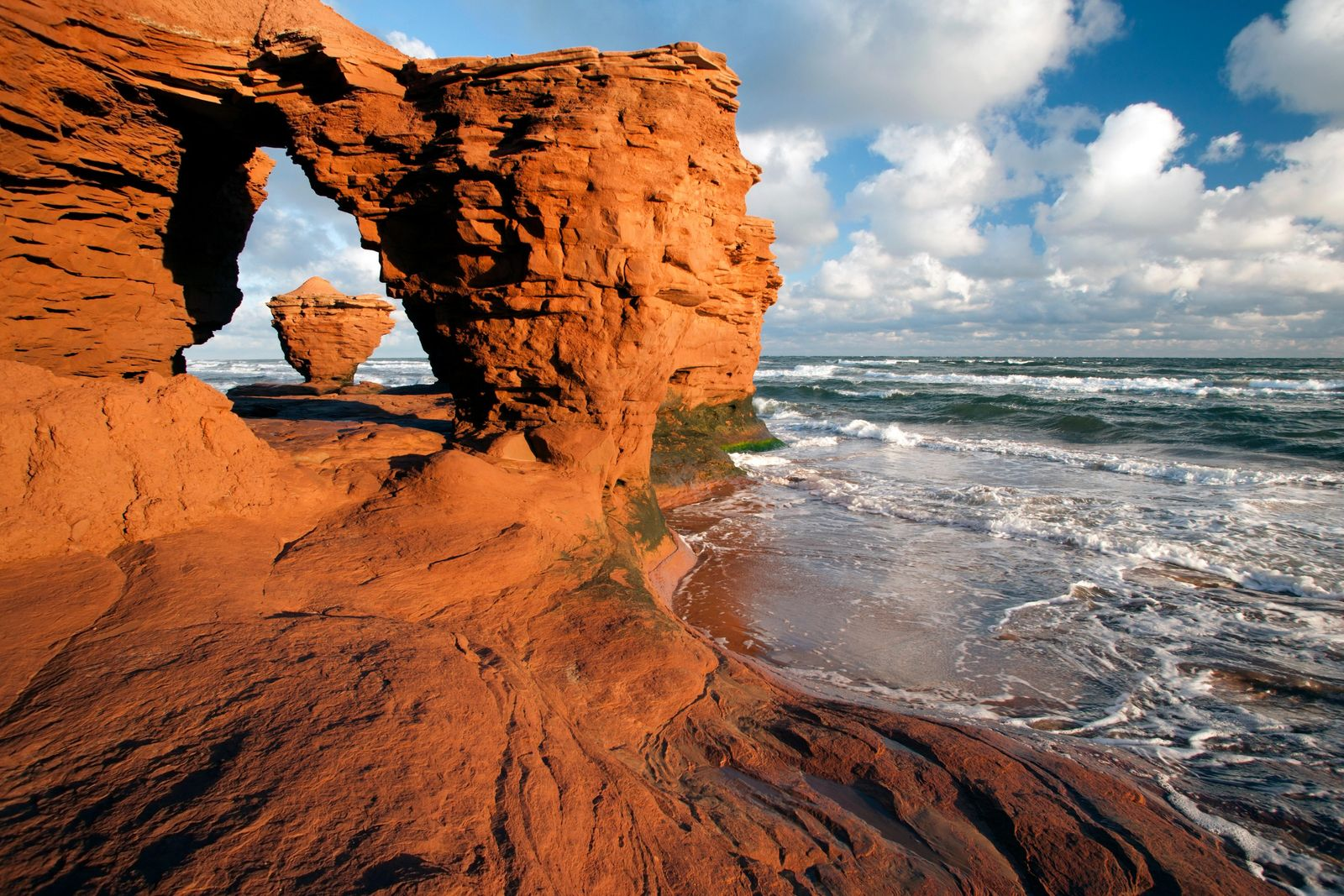 The island's north-central coast near Darnley is famous for its stunning, wind-and-sea sculpted sandstone cliffs and ...