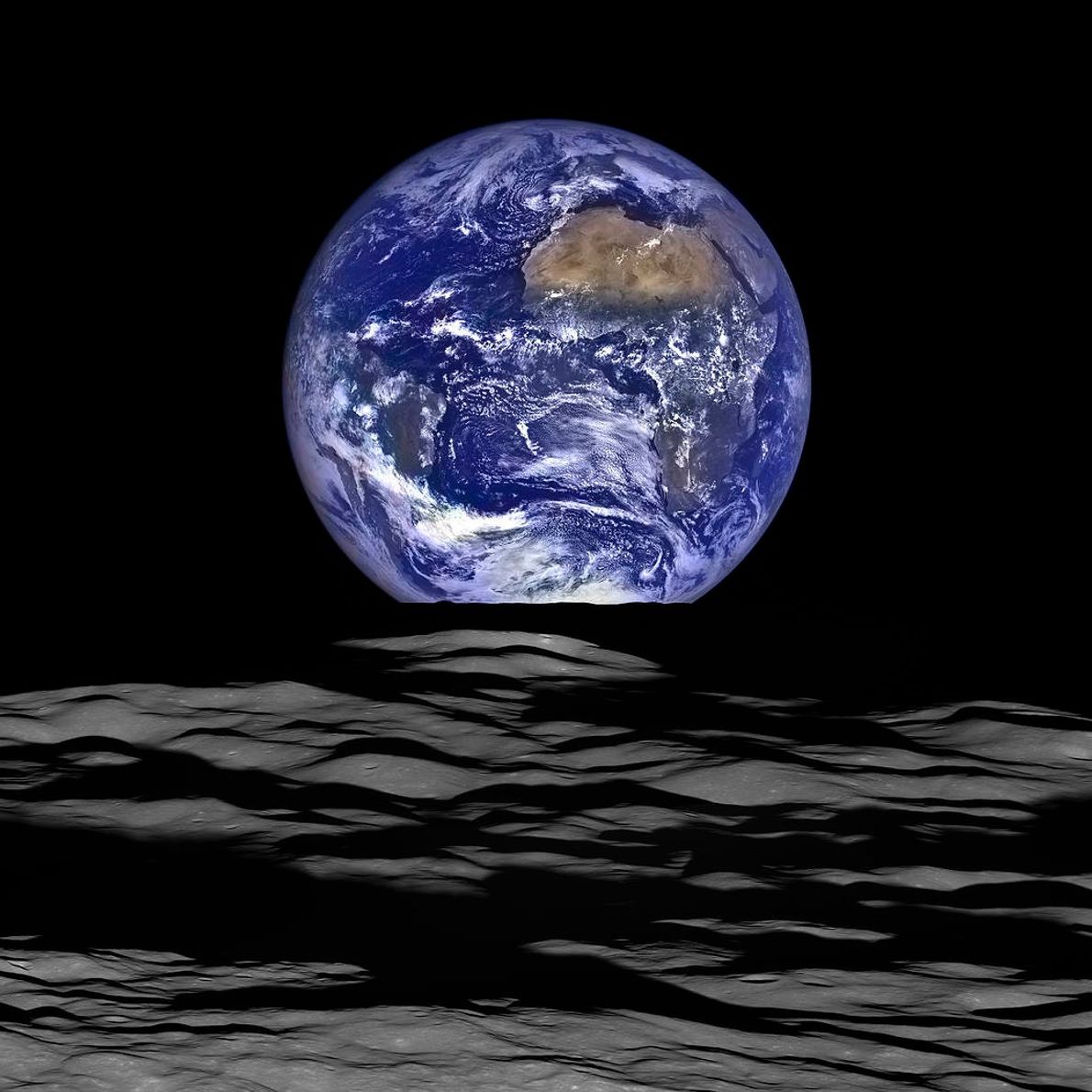 Earth appears to rise over the lunar horizon in a composite image made using data from ...