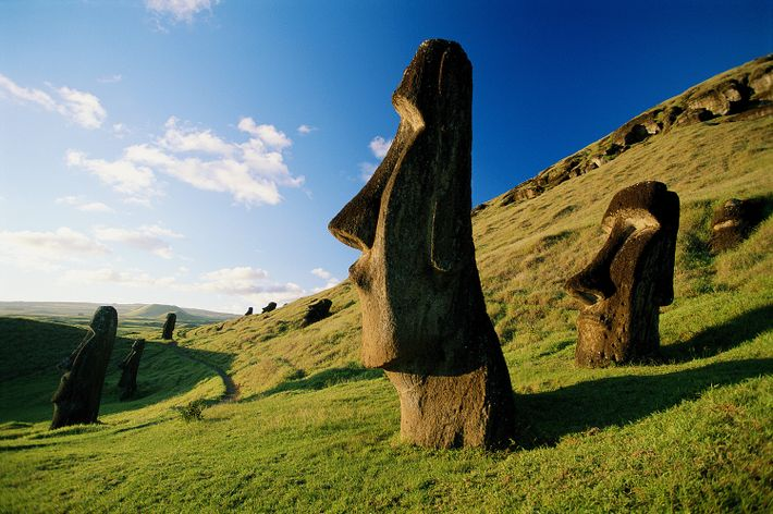 Moai dot the grassy hills of Easter Island, a Chilean territory located in the southeastern Pacific.