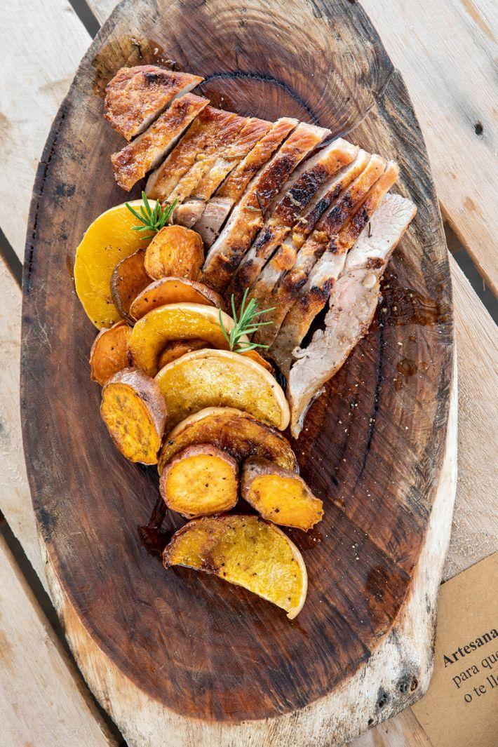 Barbecue pork with roast pumpkin and sweet potato, served at the Bodega Artesana winery.