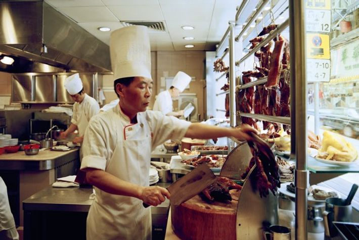 Chef preparing a cooked goose