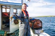 Fisherman Ross Robertson with his catch of lobster onboard the Sceptre