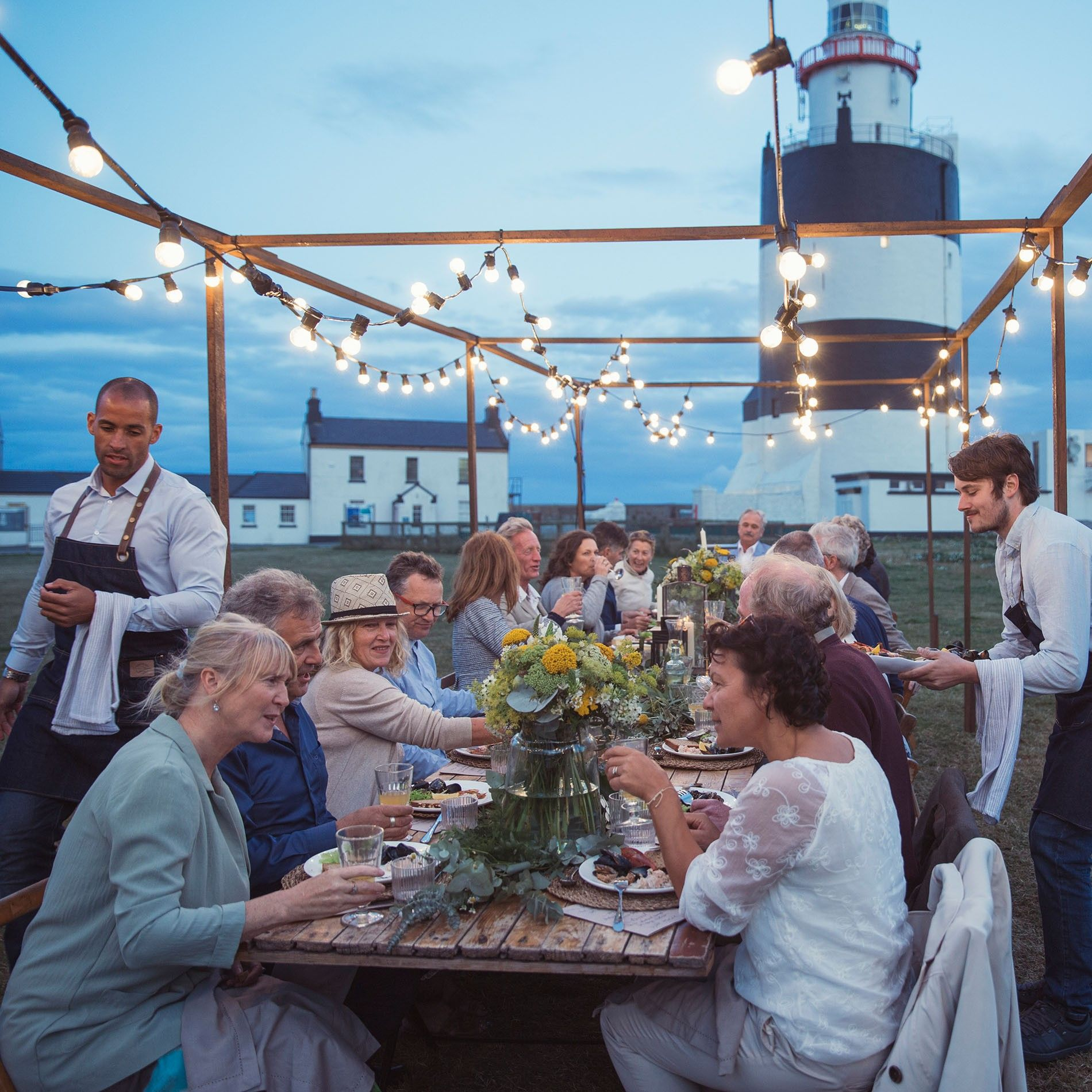 Dinner served al fresco at Hook Lighthouse, one of the most recognisable landmarks of County Wexford, ...
