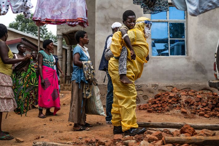 A health worker carries Kakule Kavendivwa, 14, to a waiting ambulance in Beni. The day before ...