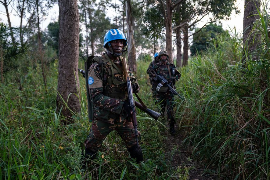 Armed guards patrol Munzambayi, an area near Beni, to combat violence against Ebola treatment centres.