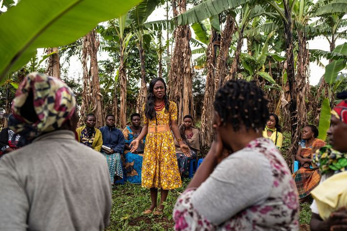 Ebola survivor Mulyanza Vithya Huguette, 24, shares her testimony with a group of women to lessen ...