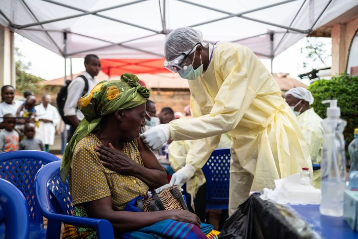 A World Health Organisation worker administers the Ebola vaccine at a converted children's hospital in the ...